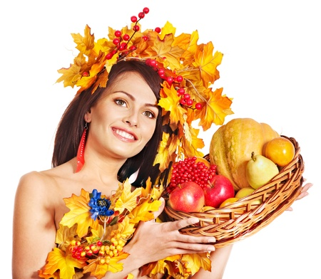 Girl with wreath of autumn leaves holding basket with fruit. Stock Photo - 15455513