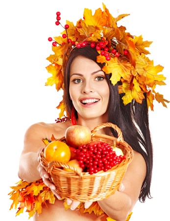 Girl with wreath of autumn leaves holding basket with fruit. Stock Photo - 15455504