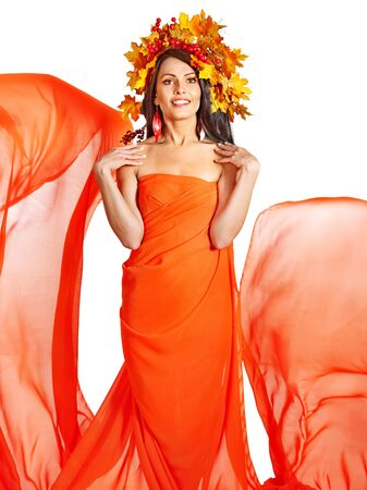 Girl with wreath of autumn leaves and orange dress. Art photo. photo
