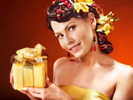 Woman with  autumn hairstyle  holding gift box. photo
