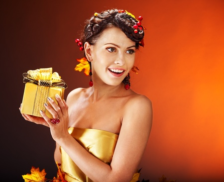 Woman with  autumn hairstyle  holding gift box. Stock Photo - 15464640