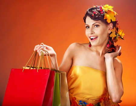 Girl with  autumn hairstyle and shopping bag. Stock Photo - 15464650