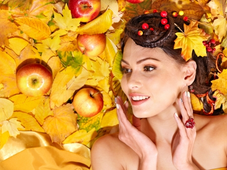 Woman holding autumn apple and leaves. photo