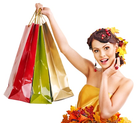 Girl with  autumn hairstyle and shopping bag. Stock Photo - 15477116
