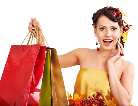 Girl with  autumn hairstyle and shopping bag. Stock Photo - 15460204