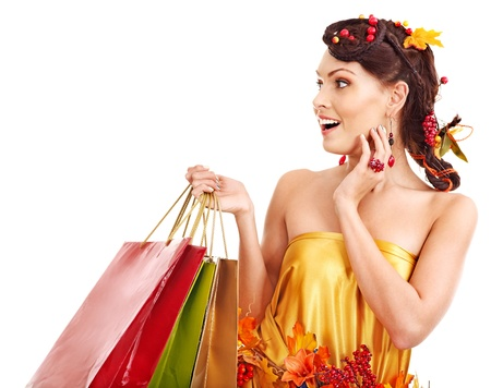 Girl with  autumn hairstyle and shopping bag. Stock Photo - 15460209
