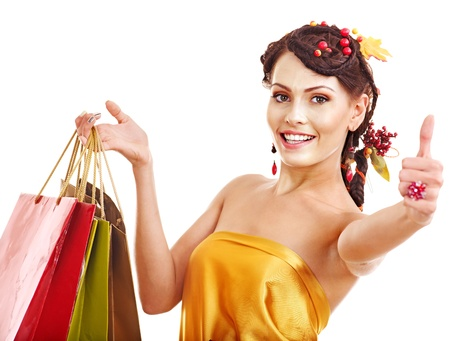 Girl with  autumn hairstyle and shopping bag. Stock Photo - 15460220
