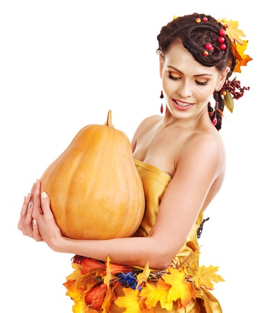 Woman holding autumn pumpkin and leaves. Stock Photo - 15477115