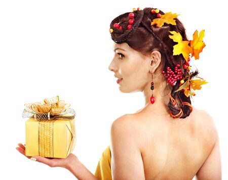 Girl with  autumn hairstyle  holding gift box. Stock Photo - 15460214