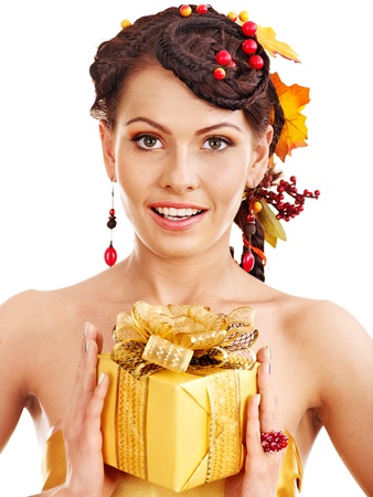 Woman with  autumn hairstyle  holding gift box. Stock Photo - 15460273