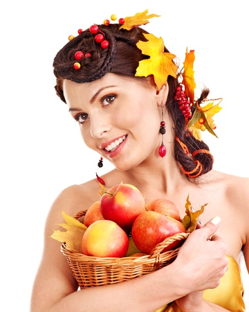 Girl with wreath of autumn leaves holding basket with fruit. Stock Photo - 15460249