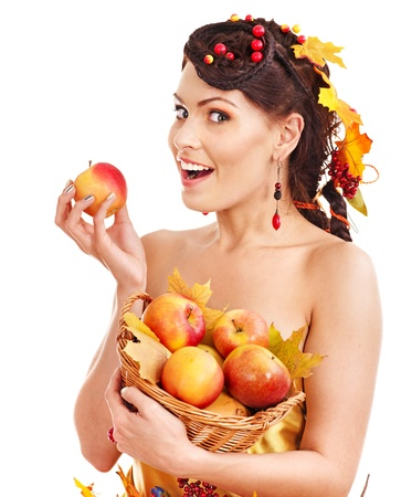 Girl with wreath of autumn leaves holding basket with fruit. Stock Photo - 15460270