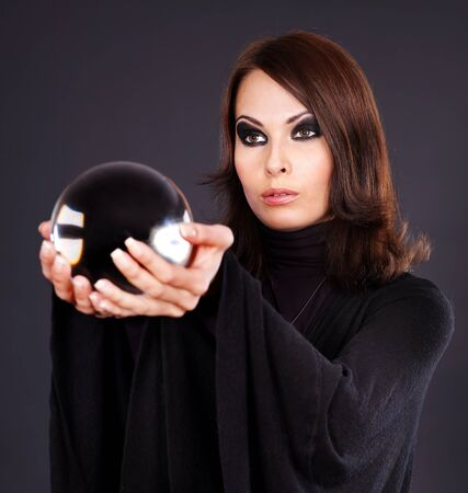 scrying: Young woman holding scrying ball
