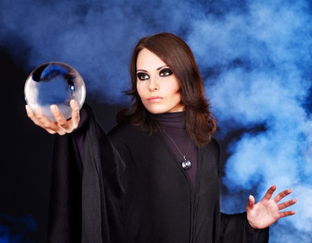 prophecy: Young woman  with crystal ball. Beauty and fashion.