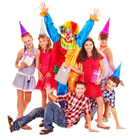 clown birthday: Birthday party group of teen people with clown. Isolated.