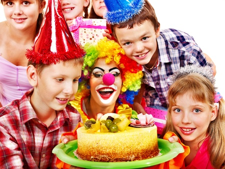Birthday party of group teen with clown and cake. Isolated. Stock Photo - 15635067