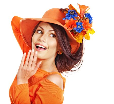 Woman wearing orange hat with flower. Isolated. Stock Photo - 15635057