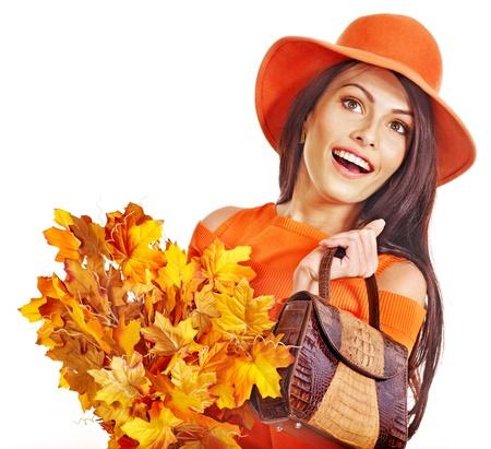 Woman holding  orange leaf and handbag. Autumn fashion. Stock Photo - 15635007