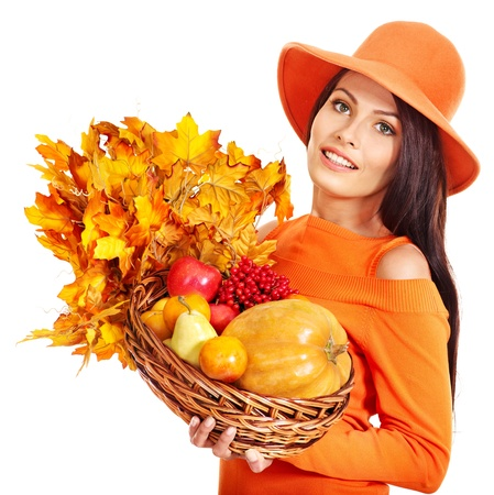 Woman holding autumn basket with fruit and vegetable. Isolated. Stock Photo - 15635145