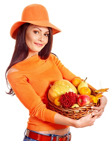 Woman holding autumn basket with fruit and vegetable. Stock Photo - 15635260
