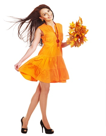 Woman holding orange leaves. Isolated.
