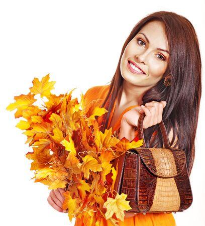 Woman holding  orange leaf and handbag. Autumn fashion. Stock Photo - 15635282