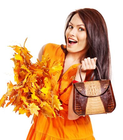 Woman holding  orange leaf and handbag. Autumn fashion. Stock Photo - 15635173