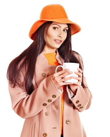 Woman wearing autumn overcoat holding  cup of coffee. Stock Photo - 15635247