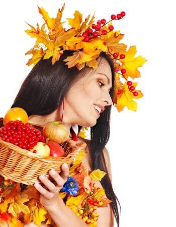 Girl with wreath of autumn leaves holding basket with fruit. Stock Photo - 15635227
