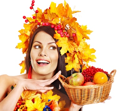 Girl with wreath of autumn leaves holding basket with fruit. Stock Photo - 15635210