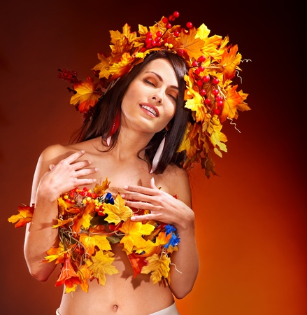 Girl with wreath of autumn leaves on the head. Art photo. Stock Photo - 15635083