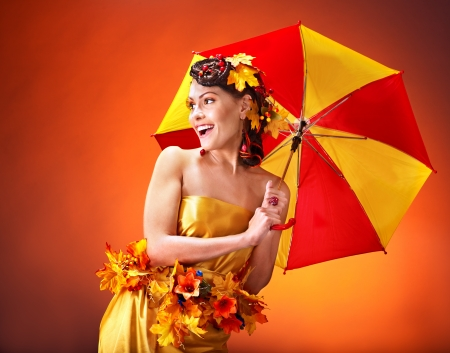 Woman with autumn hairstyle and umbrella. Fashion glamour. photo