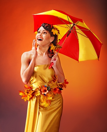 Woman with autumn hairstyle and umbrella. Fashion glamour. Stock Photo - 15635142
