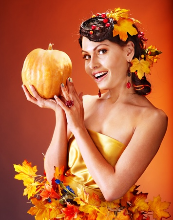 Woman holding autumn pumpkin and leaves. Stock Photo - 15635271