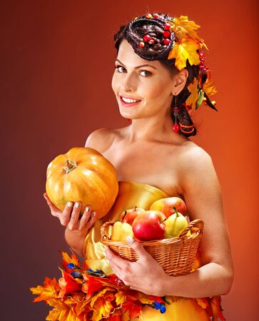 pumkin: Woman holding autumn basket with fruit and vegetable. Stock Photo
