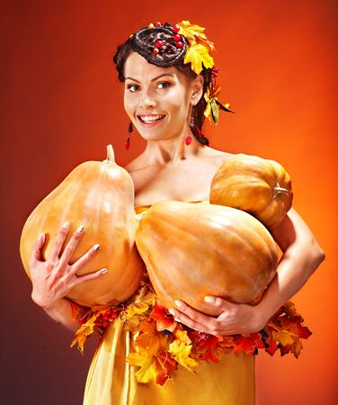 Woman holding autumn basket with fruit and vegetable. photo