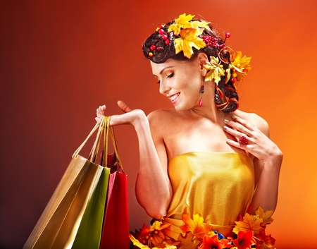 Girl with  autumn hairstyle and shopping bag. Stock Photo - 15635251