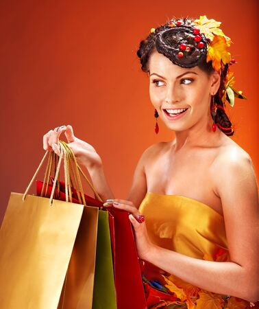 Girl with  autumn hairstyle and shopping bag. Stock Photo - 15635234