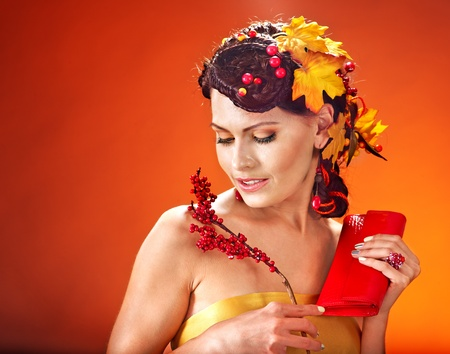 Woman with  autumn hairstyle and make up. Stock Photo - 15635223