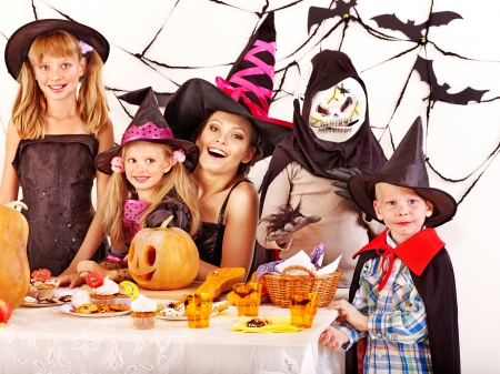 trick or treat: Halloween party with children holding carving pumkin.
