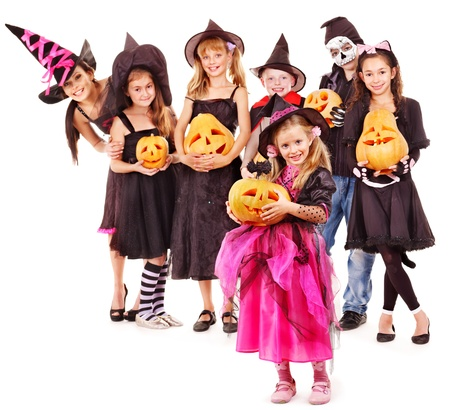 Halloween party with group children holding carving pumkin. photo