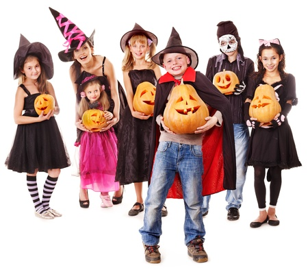 Halloween party with group children holding carving pumpkin. photo