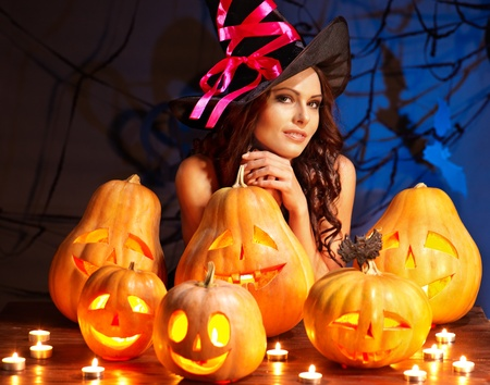 Witch woman with group Jack O'Lantern. Stock Photo - 15635020