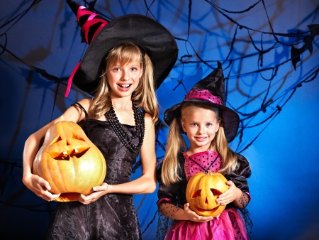 Happy witch children at Halloween party. photo