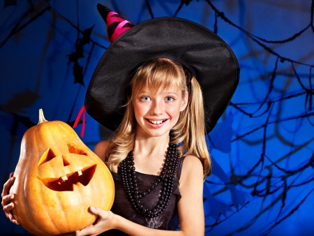 Happy witch child at Halloween party. photo