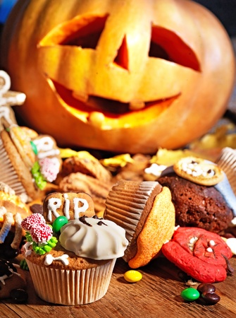 Halloween table with trick or treat. Carving pumkin. Stock Photo