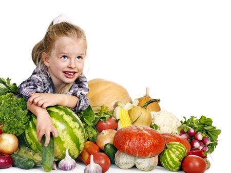 Little girl with vegetable on kitchen. Isolated. photo