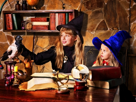 Witch  children with crystal ball. Halloween. photo