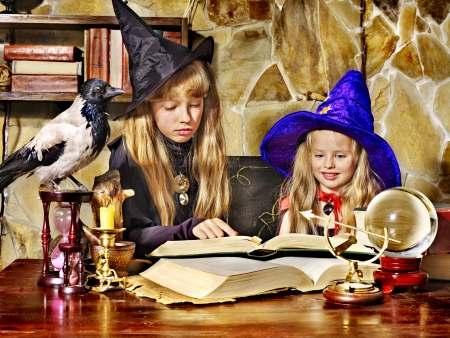 Witch  children with crystal ball. Halloween. Stock Photo - 15719136