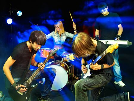 Group peole playing  guitar in night club. Stock Photo - 15718940